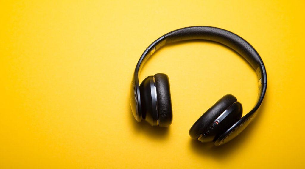 black headphones on yellow background