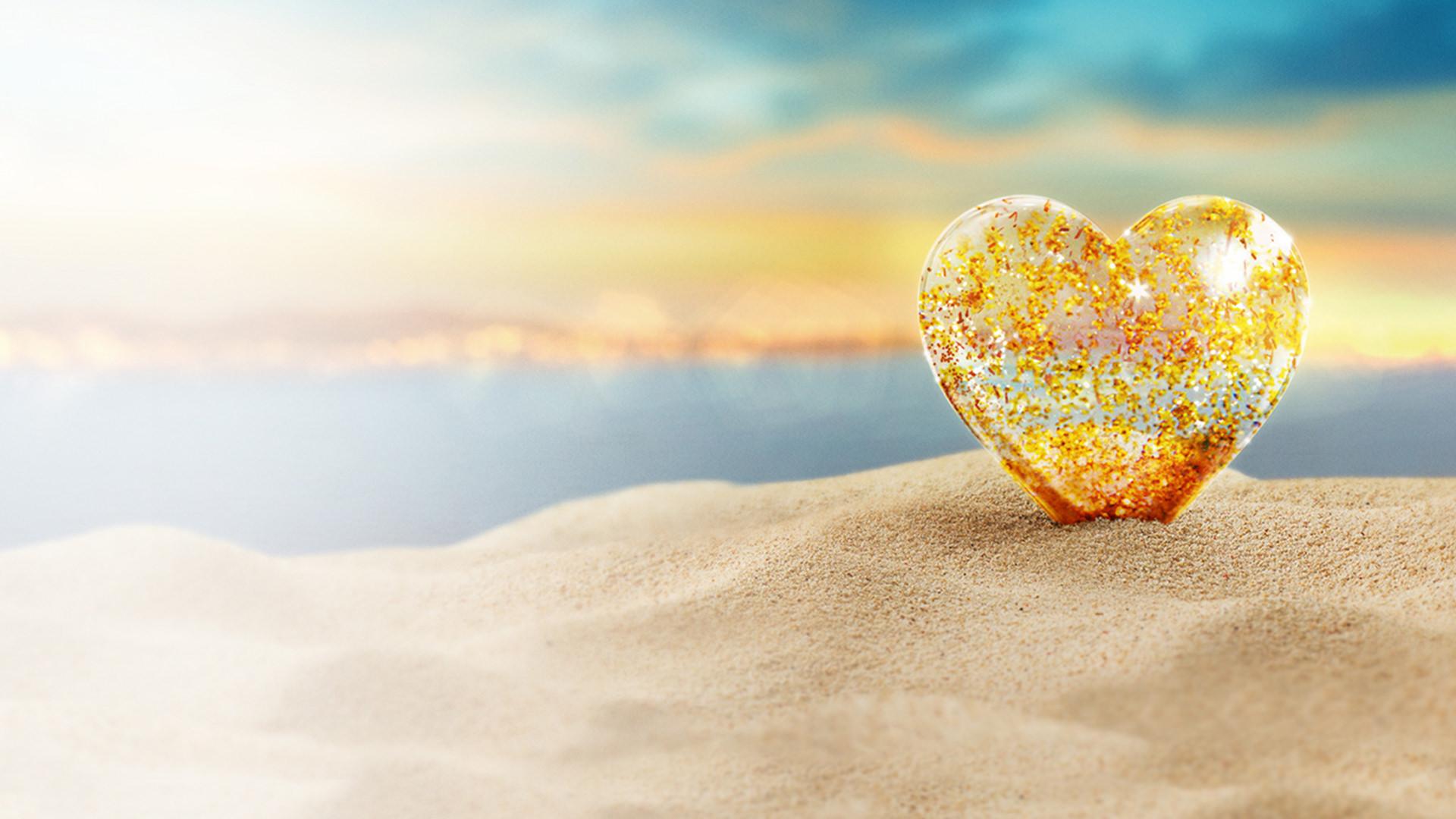 Love Island sandy beach with golden heart