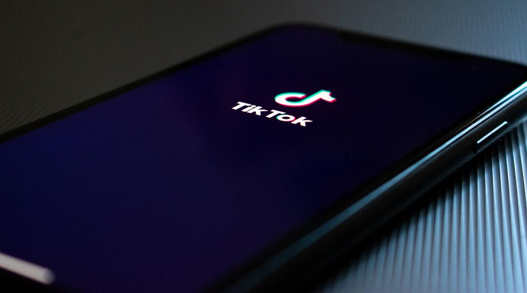 Image of phone displaying the TikTok logo